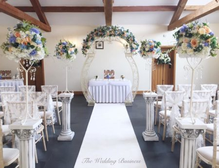 Ceremony set up, pale and ivory with white carpet entrance