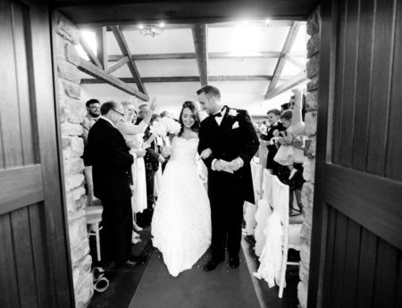 Bridal party leaving the ceremony after the big 'I Do' Wedding